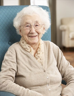 Elderly woman sitting in a health professional care home