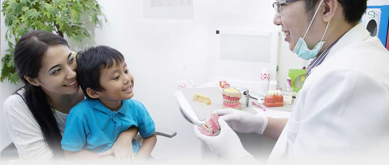 Professional dentist providing care for family