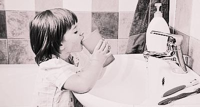 little-girl-rinses-mouth-toothbrushing-23554382